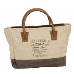 A fine quality canvas bag with leather handles and a Parisian Patisserie printed slogan.