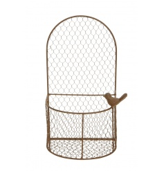 A rustic chicken wire style hanging wall planter with a decorative bird ornament.