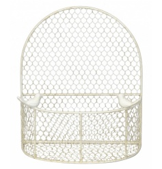 A shabby chic style metal cream wall basket. Ideal for planting up.