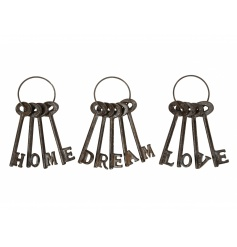 An assortment of 3 decorative keys, with each spelling LOVE, HOME or DREAM.