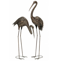 An assortment of 2 stunning metal herons with a bronze rustic finish.