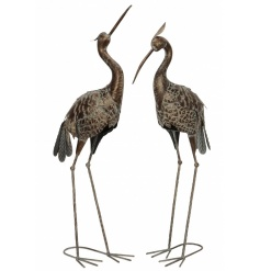 An assortment of 2 rustic heron garden ornaments, each with a bronze textured finish.