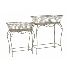 A set of 2 rustic style display stands. Ideal for merchandising stock and for use as planters.