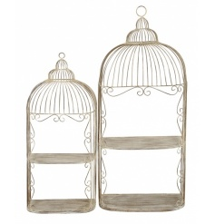 A set of 2 ornate open bird cage display cases with 2 shelves for display and storage.