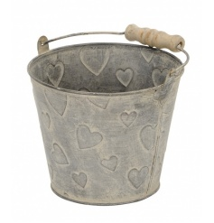 A charming rustic style metal bucket with wooden handle and embossed heart detailing.