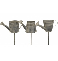 An assortment of 3 rustic watering can style planters with stake. Ideal for displaying in your garden.