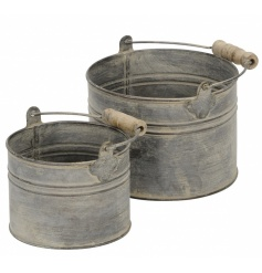 A set of 2 antique style metal round buckets. Ideal for planting, display and decorative use.