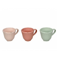 An assortment of 3 pastel coloured teacups each with a shabby chic finish.