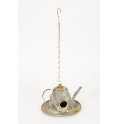 A unique hanging teapot shaped bird house with a distressed finish.