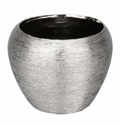 A silver decorative vase with a textured finish. A stylish home accessory which looks lovely displayed as pictured