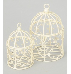 A set of 2 small cream bird cages, which are ideal for table decorations. Fill with sweets, favours or led t-lights.