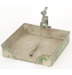 A rustic style metal napkin holder with a distressed finish and tap weighted holder.