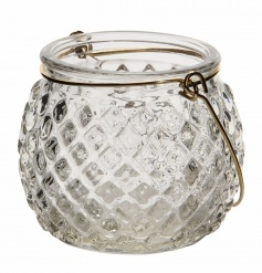 An antique inspired decorative glass t-light holder with gold handle.