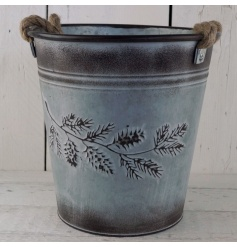 A grey washed zinc bucket with chunky rope handles and an autumn design.