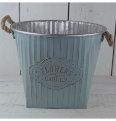 A square shaped planter with an embossed Flowers & Gardens badge, complete with chunky rope twin handles.