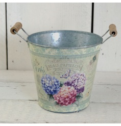 A rustic planter with twin handles and a pretty hydrangea decal.