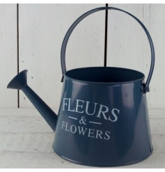 A rustic metal watering can in a stylish navy finish with a Fleurs and Flowers print.