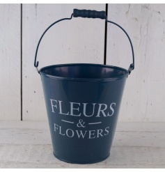 A stylish navy bucket with a Fleurs and Flower print. A great item for planting, storage and hampers.