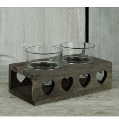 Shabby and chic candle holder made of wood with heart cut outs