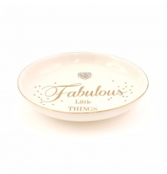 A stylish gold polkadot dish which is ideal for storing your fabulous little things!