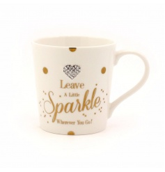 Leave a little sparkle wherever you go! A fabulous mug with polkadot design and heart gem to finish.