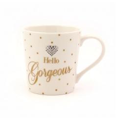 Hello Gorgeous. A stylish gold polka dot mug with heart shaped gem.