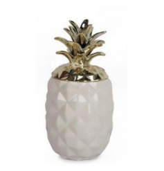 Stylish new modern home keepsake trinket pot. With a gold lid and a white base.