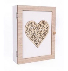A shabby chic style wooden key box with a decorative heart design.