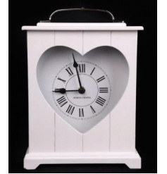 A shabby chic style white mantle clock with a heart cut out feature.