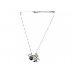 A beautiful silver necklace with charms including a wishbone, star and heart.
