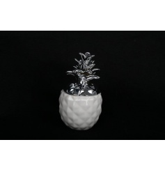 A ceramic decorative pineapple ornament with removable lid, perfect for storing your trinkets.