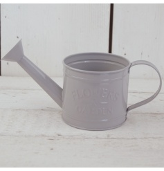 A shabby chic style watering can planter with an embossed flowers and gardens slogan.