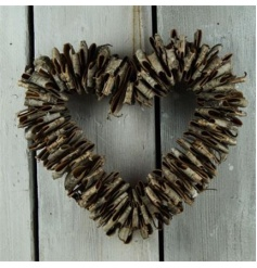A rustic style birch wreath with a chunky rope hanger.
