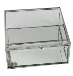 A chic trinket box in glass with silver trim. Comes gift boxed.