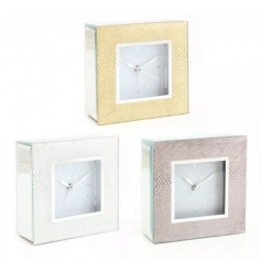 An assortment of 3 alarm clocks, each with a stylish snake print design in silver, gold and pink colours.