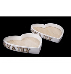 A set of 2 wooden heart shaped trays with Neat& Tidy lettering.