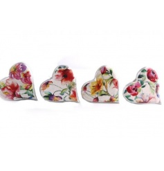 Set of 4 beautiful floral patterned wooden hearts.