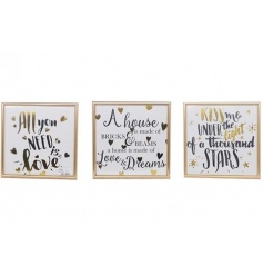 An assortment of 3 stylish framed slogan plaques each with gold foil and decorative stars or hearts.