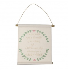 A charming fabric hanging sign with love slogan and a pretty heart and floral design.