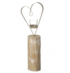 A rustic style t-light holder with a metal heart decoration.
