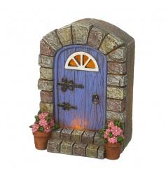 An enchanting light up solar powered fairy door. A magical ornament for the garden.