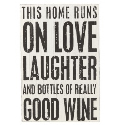 A white and black shabby chic sign with love, laughter and wine slogan.