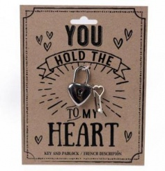 You hold the key to my heart. A stylish heart shaped lock with heart shaped keys.