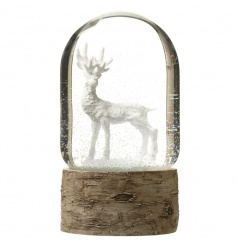 A charming woodland style snow globe with white reindeer.