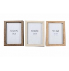 An assortment of 3 wooden photo frames in tonal natural colours.