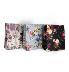 An assortment of 3 romantic floral gift bags in blue, black and soft mauve designs. Each comes with a gift tag.