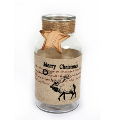 A decorative glass bottle with a stag design wrap, jute string and festive wooden star.