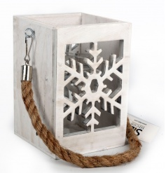 A rustic style snowflake design lantern with a chunky rope handle.