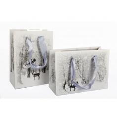 An assortment of 2 beautiful winter wonderland reindeer scene gift bags with ribbon handles