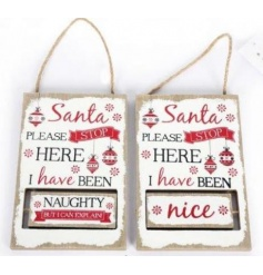 Decide who's been naughty or nice this season with this unique nordic style spinning sign.